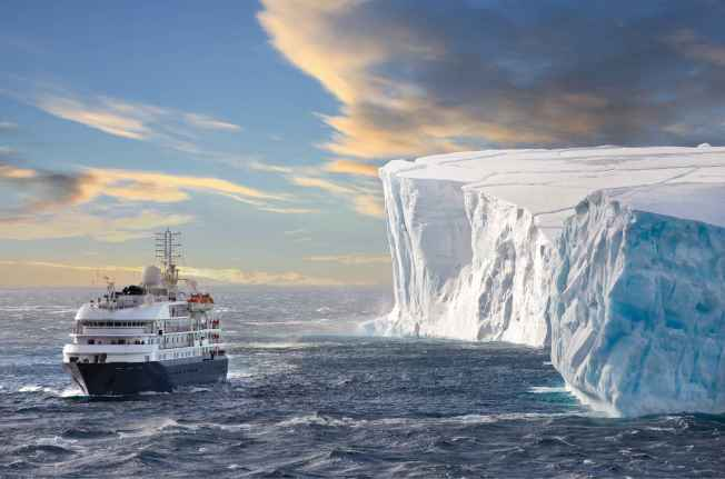 The cruise ship Corinthian II in front of a huge Iceberg in Antarctic Sound. Antarctic Sound is at the northern tip of the Antarctic Peninsular and connects the Southern Ocean to the Wedell Sea. Even in the summer months it is often filled with huge tabular icebergs